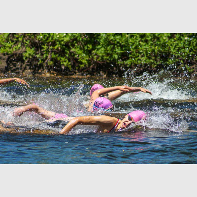 Triathlete swimmer Andreanne Briere breathing in a race